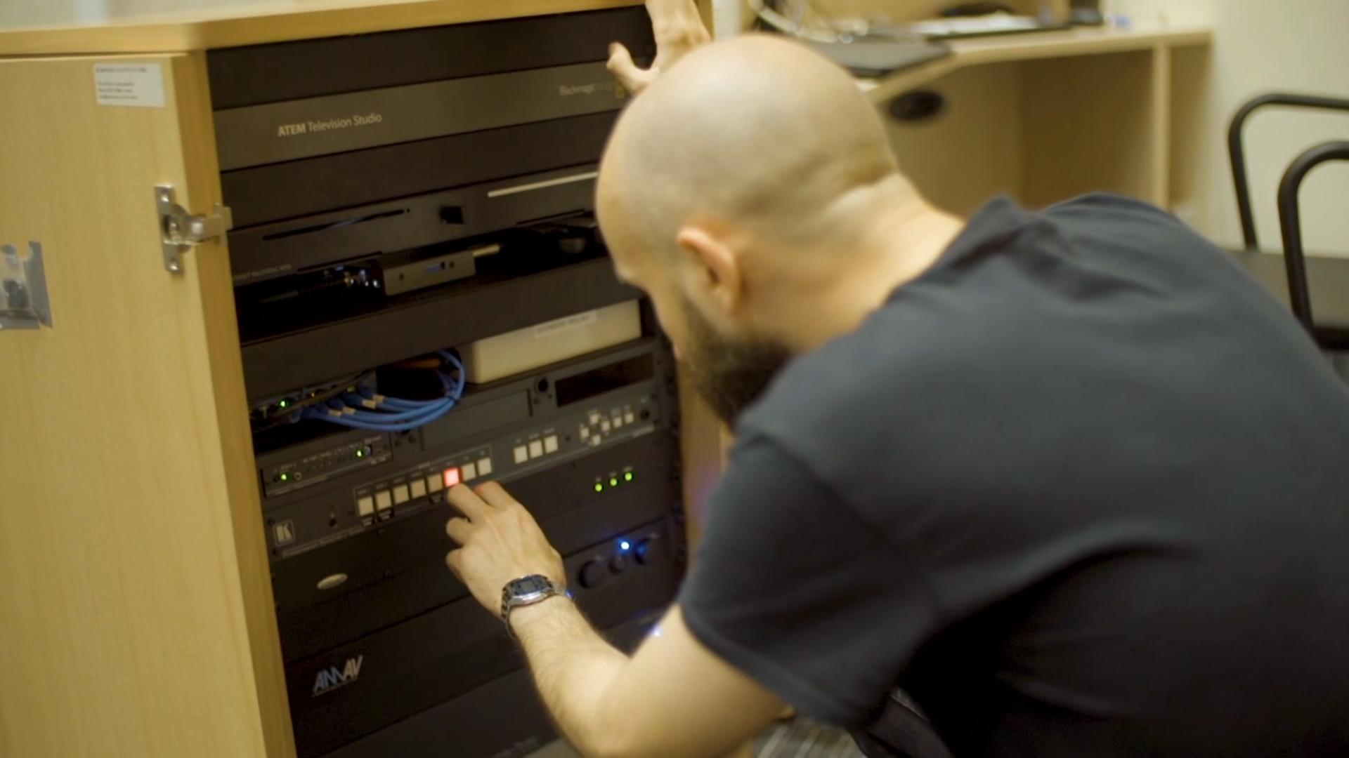 public-i AV engineer setting up a FX800 system
